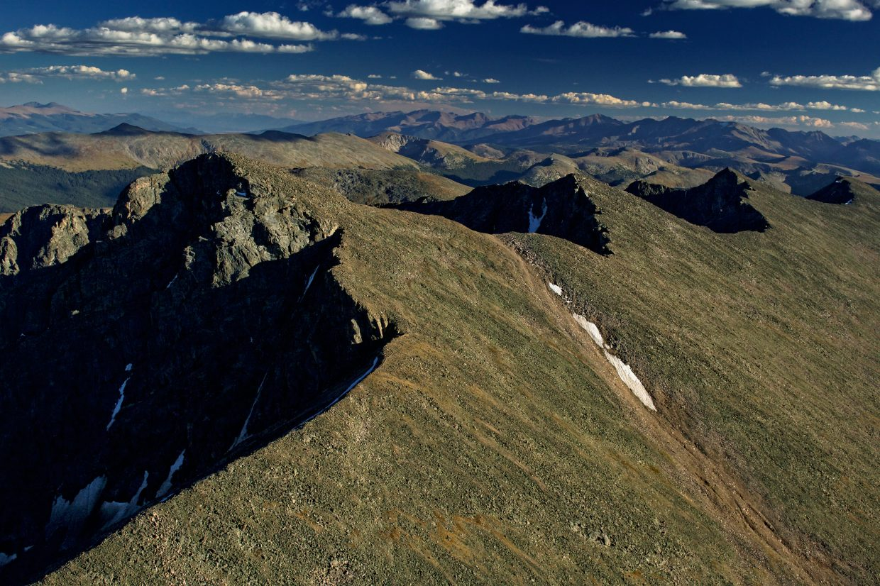 An eagle's-eye view of Mount of the Holy Cross, shot from Garrett Fisher's Piper PA-11. Fisher lives in the area and publishes photo books of Rocky Mountain mountains and glaciers.