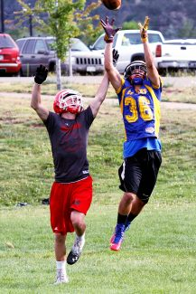 Christopher Mullen Post Independent Sergio Vega 36, of the Roaring Fork Rams jumps up to catch the ball, just out of the reach of Evrett Marr 88, playing for the Glenwood Springs Demons. During a 7 on 7 game at Roaring Fork High School July 15, Basalt, Rifle, Coal Ridge, Carbondale and Glenwood Springs all played, rotating on two fields. They were given four downs to score a touchdown, the 7 on 7 games gave the players a refresher during the summer, their football practices will start August 11.