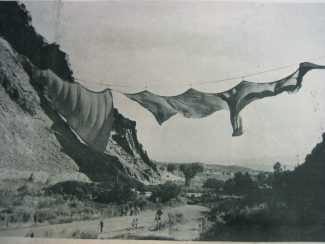 Funded by national and international donors and by the sale of his own works of art, Christo created and installed the Valley Curtain at Rifle Gap on Aug. 10, 1972. However, the vibrant orange curtain could not withstand the winds of Rifle Gap, and was destroyed by the wind 28 hours after its completion, as seen in this photograph.