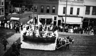 The Strawberry Day Parade of 1914 passes by the Kamm Building on the corner of Eighth and Grand. Considered to be the first brick commercial structure constructed in Glenwood Springs, the building has, in its 129-year history, housed a number of Glenwood Springs businesses, including Dever Jewelry and currently Confetti Design.
