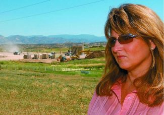Post Independent Photo/Kara K. PearsonEnCana well pad G33 stands behind Laura Amos and her Silt home. Amos contends that hydraulic fracturing fluid has contaminated her water.