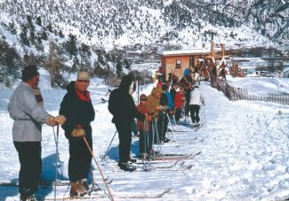 Frontier Historical SocietyEager skiers in the early 1950s wait for a chance to board the lift at the Red Mountain Ski area in Glenwood Springs. The Red Mountain Ski Area was built on property donated by J.E. Sayre in the late 1930s. However, sporadic snowfalls and the competiveness of Colorado's ski industry forced the area to close in 1966.