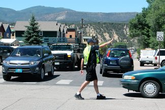 Carbondale Police Lieutenant Chris Wurtsmith directs traffic through the detour at the corner of 8th and Colorado on Tuesday afternoon.