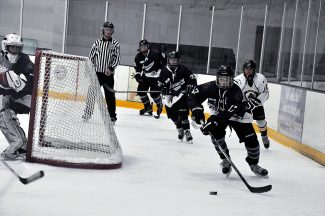 Mathew Thrun (17) of the Glenwood Springs Grizzlies Bantam Silver hockey team advances the puck while teammate Gavin Olson (23) trails during a game against Aspen in Steamboat Springs this past weekend.