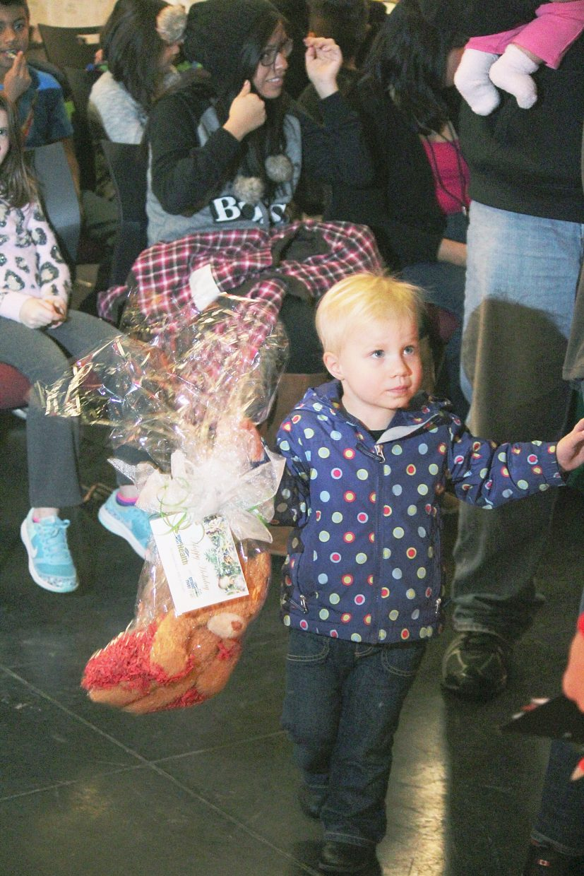 Ella Slappey holds a prize after the yule log scavenger hunt Friday.