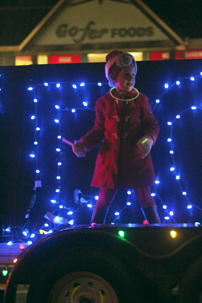 A young girl dances on a float in the 2015 Hometown Holiday Celebration Parade of Lights.