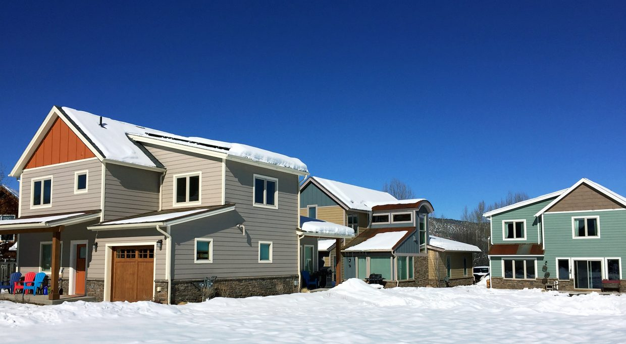 Three of the four completed Habitat for Humanity houses at Carbondale's Keator Grove.