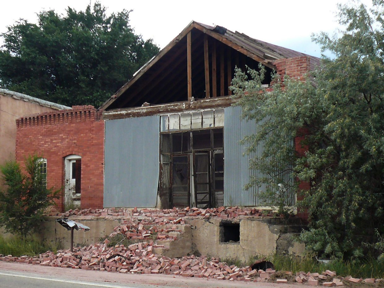 The front of this brick building collapsed (note crushed mailbox) in Segund after the 2011 Trinidad earthquake.