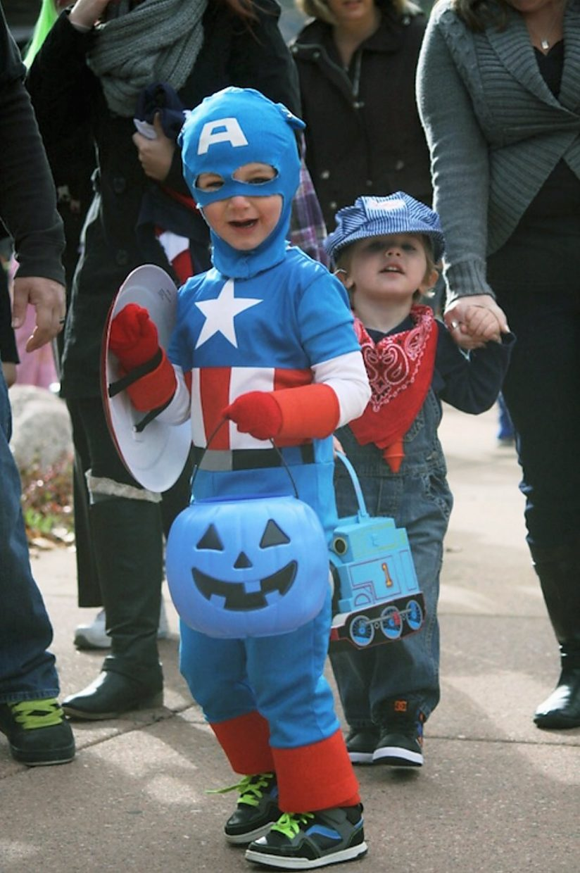 Dressed as Captain America, Carter Roberts, 4, heads to City Hall for some candy.