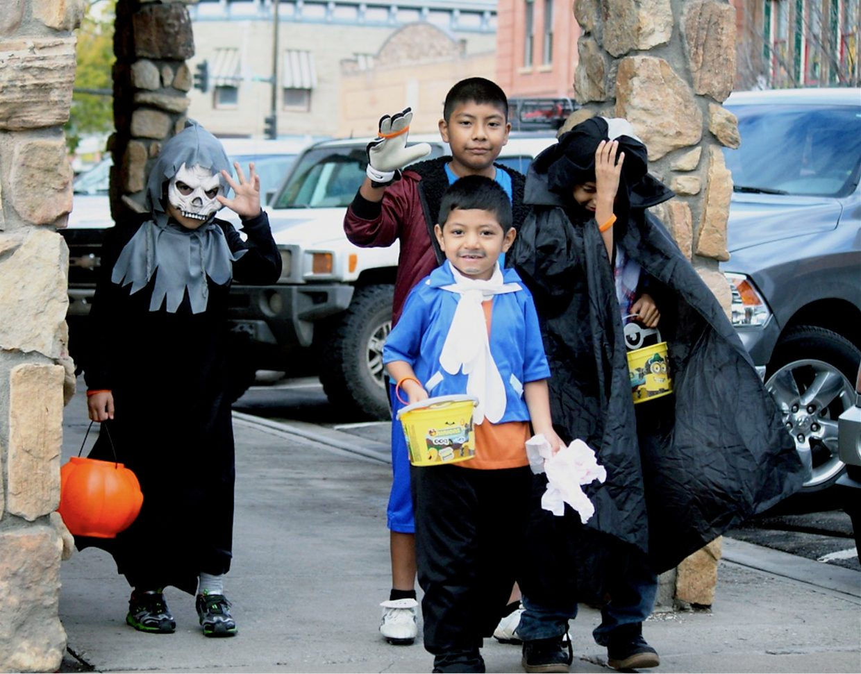 Trick-or-treaters make their way down Third Street during the annual Rifle Branch Library Halloween Parade Friday, Oct. 30. Nearly 500 costumed trick-or-treaters and parents turned out for the event.
