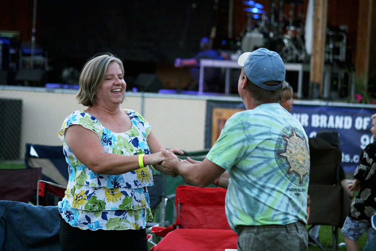 Hedi and Scott Young, of Silt, dance in Stoney Ridge Park Friday night at the 46th annual Silt HeyDays.