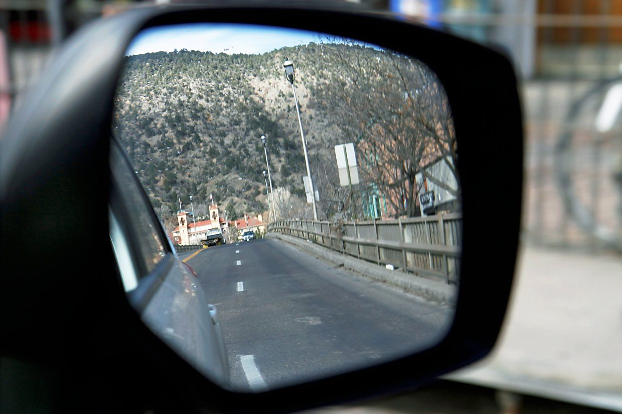 Hotel Colorado reflected in a mirror as vehicles cross the Grand Avenue bridge in Glenwood Springs.