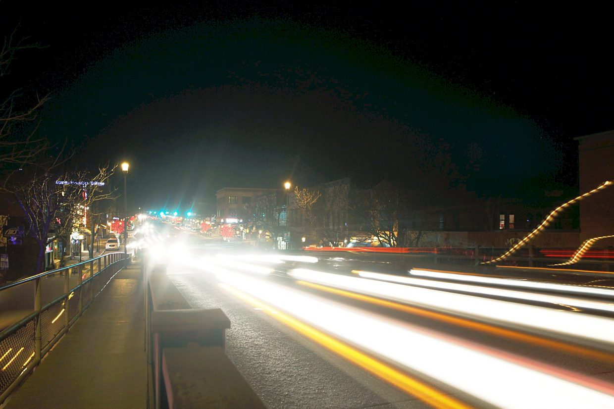A night view of Grand Avenue/State Highway 82 traffic in Glenwood Springs.