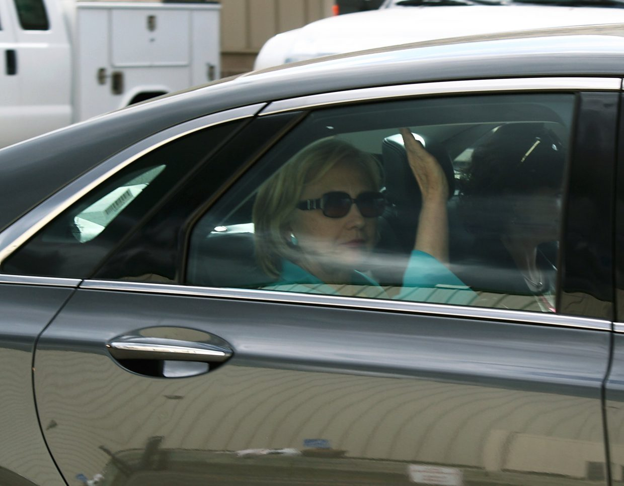 Hillary Clinton waves as she arrives Tuesday afternoon at the Rifle-Garfield County Airport.