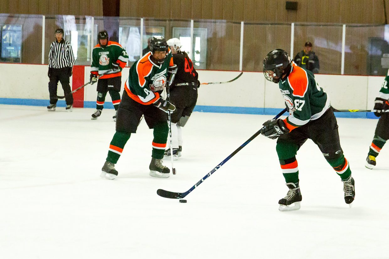 John Sherman, number 87, helps lead his team to a 4-1 victory on Sunday morning against the Glenwood Brewpub.