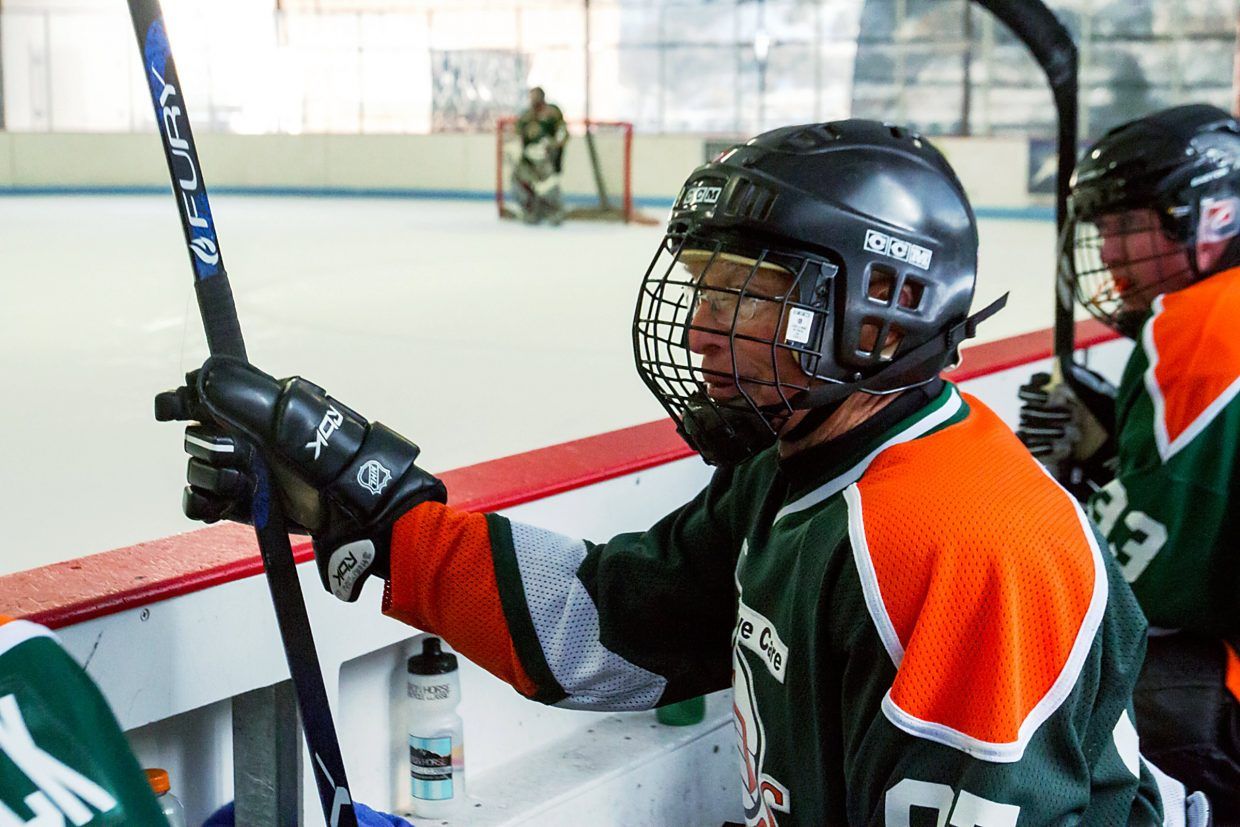 Hockey player John Sherman cheers on his team, 20/20 Vision, Sunday morning at the Glenwood Springs Community Center.