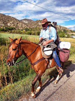 Pat Schumacher is riding his horse, Dillon, 600 miles from Colorado to Utah to attend his brother's wedding. He has his pug dog, Buford, along for the trip, riding on his backpack over his left shoulder. Schumacher made state and national news last week when he failed a sobriety test after being pulled over on his horse in Boulder. After a night in jail, he is back in the saddle and continuing his journey, traveling through Garfield County on Monday. This photo was taken west of New Castle on Highway 6.