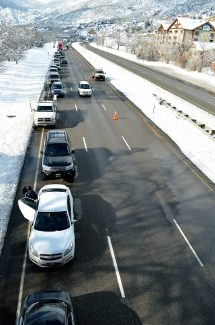 Motorists wait along the side of Interstate 70 during a closure of Glenwood Canyon on Saturday afternoon. The Colorado Department of Transportation reopened the canyon at 2:10 p.m., but some drivers had been waiting for the reopening for close to an hour.
