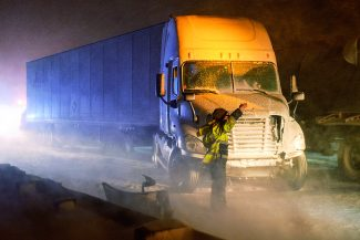 A worker gestures at the site of a multi-vehicle crash in Glenwood Canyon Thursday night. Westbound Interstate 70 was closed beween about 8 p.m. and 10 p.m. There were no injuries.