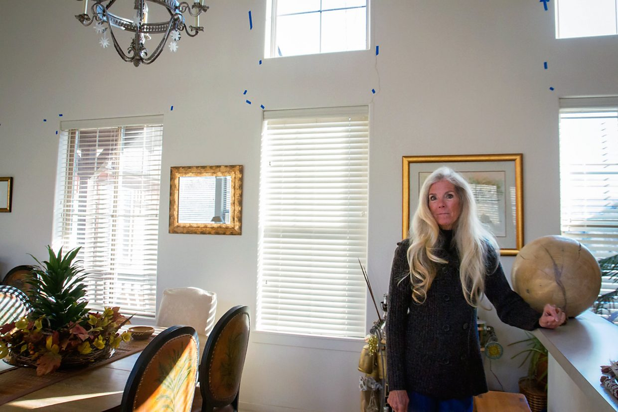 Sam Mosher, a homeowner in the Ironbridge Subdivision, has experienced a constant progression in the deterioration of her house's foundation. The walls of her house have been cracking for more than nine years. She started putting blue tape on the walls to track the progression of the cracks.