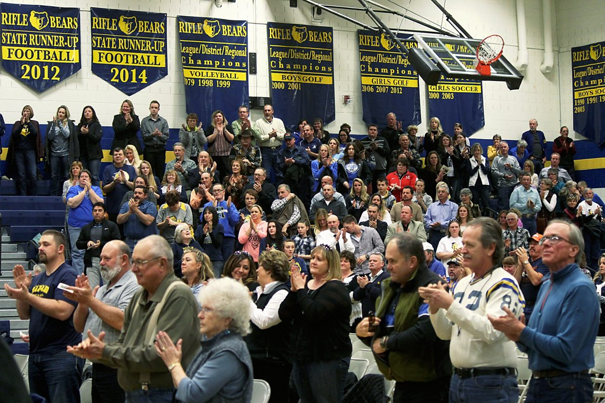 The audience at a memorial service Saturday delivers a standing ovation in memory of Jack Smith.