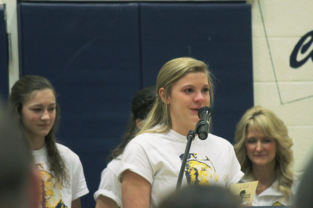 Jessie Pressler, a member of the Rifle girls golf team, shares some of her memories of coach Jack Smith during a memorial service Saturday at Rifle High School.