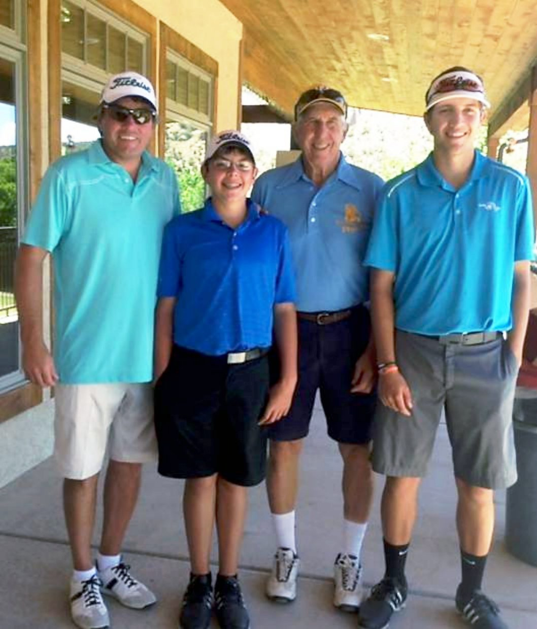 Participating in the Jack Smith scholarship tournament at Rifle Creek Golf Course on Aug. 2 were Jack Smith, back, and from left, his son, Tod Smith, and grandsons, Jacob and Kyler Smith.