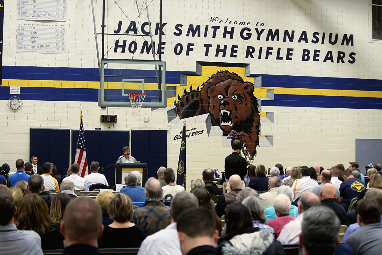 The recently painted new name of the Rifle High School gym, the Jack Smith Gymnasium, looms large Saturday over a memorial service remembering the longtime and beloved coach.
