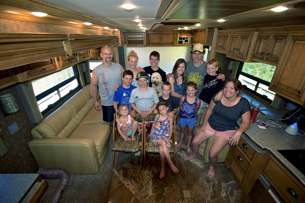 The Kellogg family in their RV, from left, top row: Dan, Kady, Brody, Eddy (the dog), Karrie, Grady and Rowdy; middle row: Dally, Kenny, Cardy, Maddie, and Susie; and bottom: Elly and Emmy. Not pictured because he was taking a nap: 2-year-old Coby.