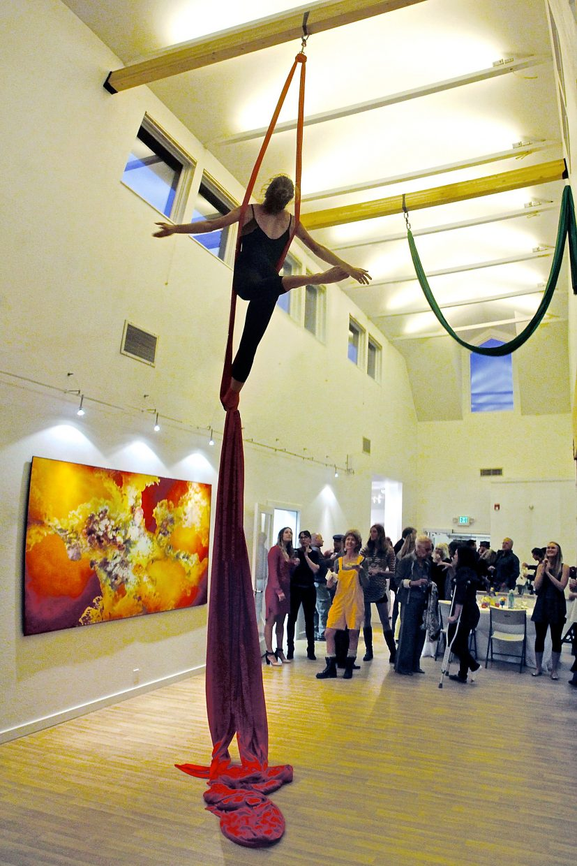 Jacqui Edgerly is suspended above the crowd at a special Carbondale Council on Arts and Humanities anniversary event in October. The CCAH is housed at The Launchpad, a multipurpose space with a gallery and dance rooms where events can be held.