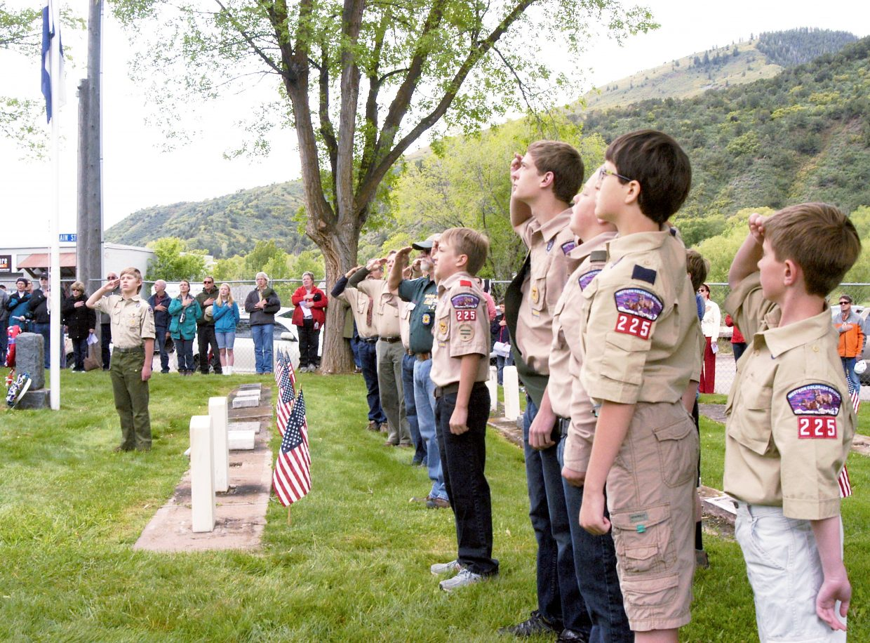 Members of Boy Scout Troop 225 salute the flag during the singing of the National Anthem as part of the Glenwood Springs Memorial Day ceremony at Rosebud Cemetery on Monday.