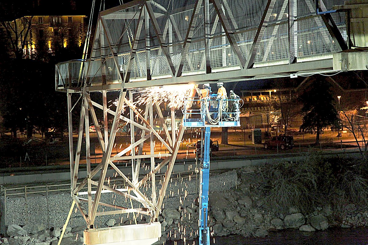 The work to remove the existing pedestrian bridge began Tuesday night.