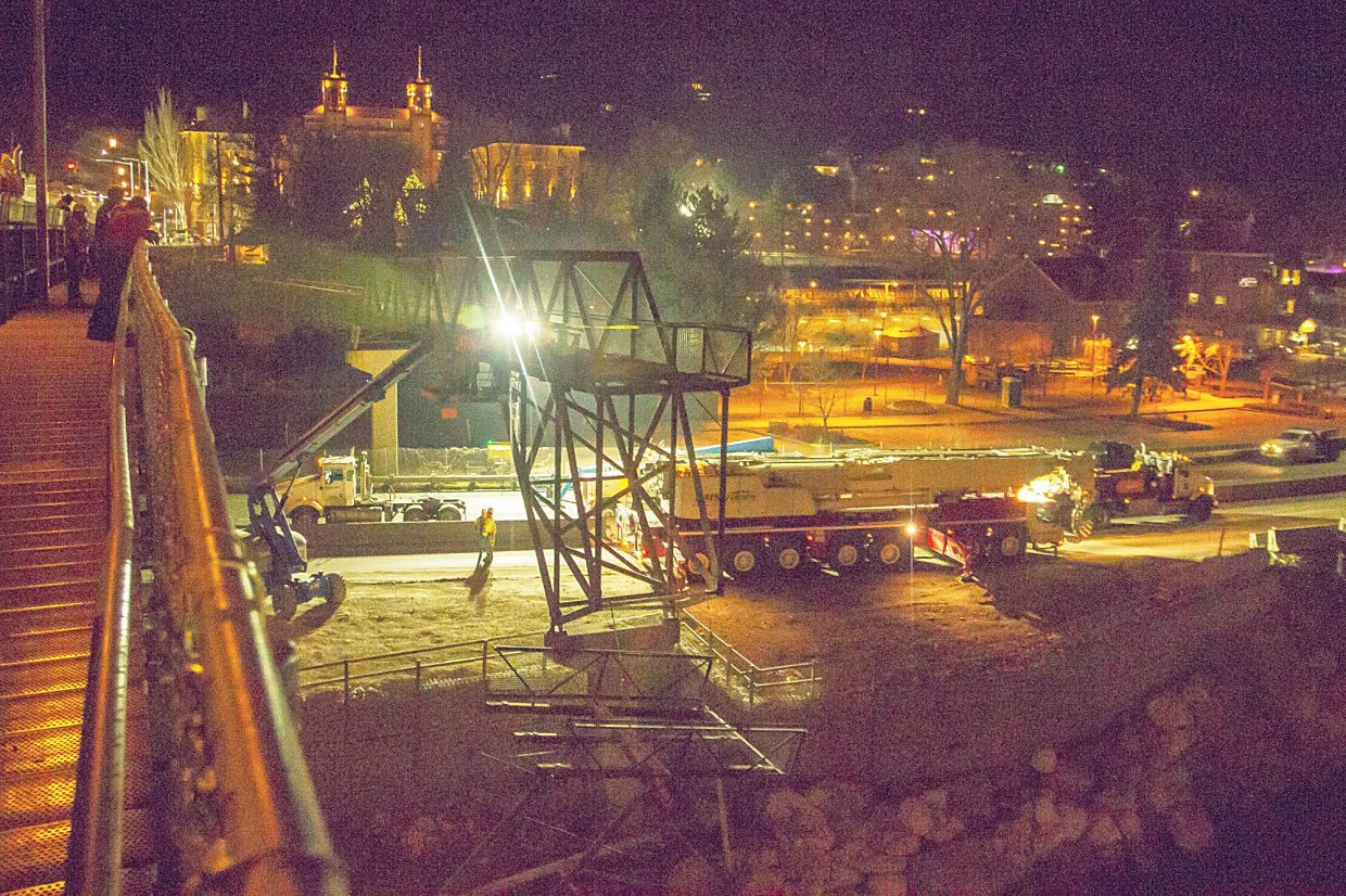 The portion of the Grand Avenue pedestrian bridge that goes over Interstate 70 was removed late Wednesday night while traffic was detoured onto Sixth Street at theYampah Mountain Spa and Vapor Caves.
