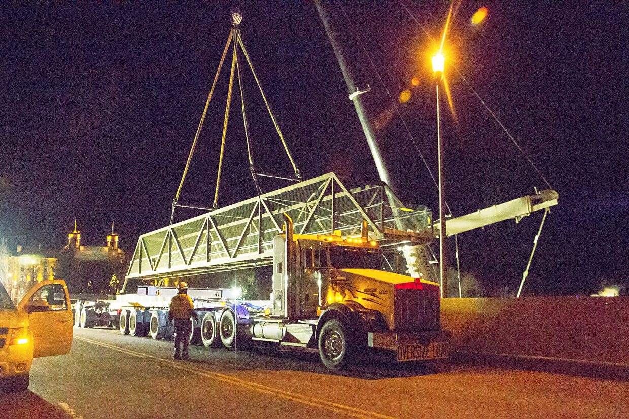 The 108 foot section of the pedestrian bridge was cut free and lifted into the air around 2:30 a.m. on Thursday. This section of the bridge was taken behind Glenwood Springs High School until it will be used as a new pedestrian bridge across the Roaring Fork River.