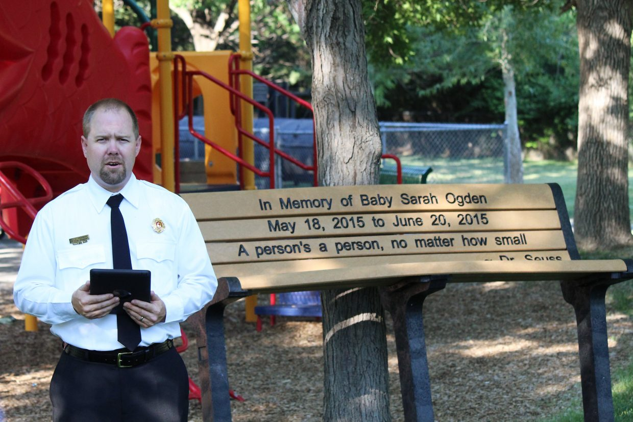 Jed Johnston, fire chaplain with the Grand Valley Fire Protection District, delivers remarks Monday during a dedication ceremony remembering Sarah Ogden, the month-old child beaten to death in her Parachute apartment a year ago to the day. The Remembering Sarah Ogden Committee raised money during that time for a bench that will be placed in Cottonwood Park. Garfield County Coroner Robert Glassmire said the committee is working with the town of Parachute on a set location for the bench in the park. Johnston said the remaining funds will be donated to the River Bridge Regional Center, a nonprofit child advocacy center in Glenwood Springs.