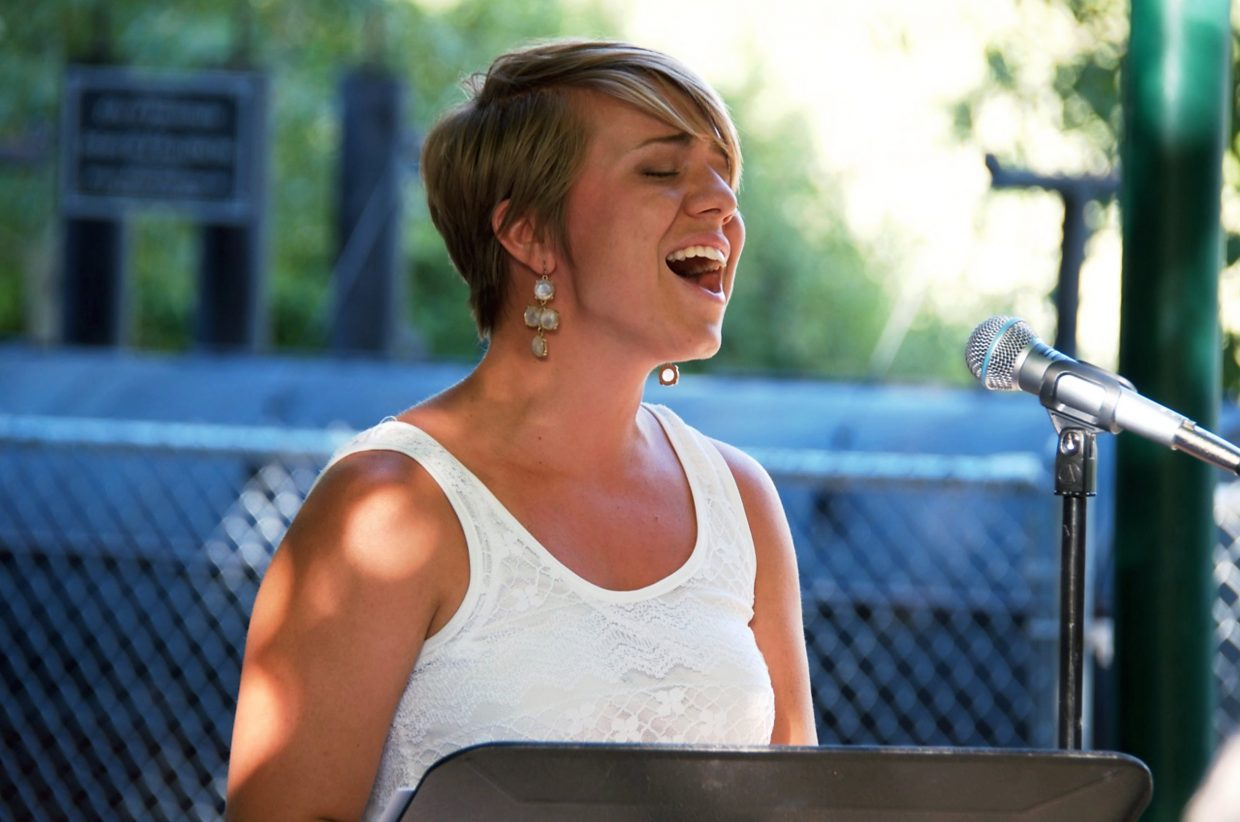 """Christina Klossner sings """"Amazing Grace"""" to close the memorial ceremony for baby Sarah Ogden."""