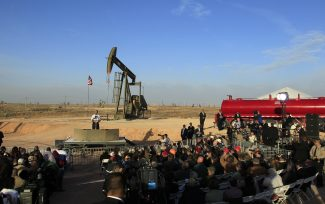 In this March 21, 2012, file photo, with oil pump jacks as a backdrop, President Barack Obama speaks at an oil and gas field on federal lands in Maljamar, N.M. The government has failed to inspect thousands of oil and gas wells it considers potentially high risks for water contamination and other environmental damage, congressional investigators say.