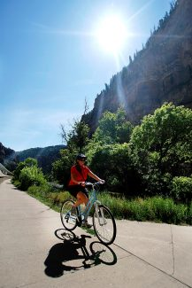 Cheryl O'Brien rides through Glenwood Canyon in this Glenwood Springs Post Independent file photo. The canyon path is now open for the season, weather permitting.