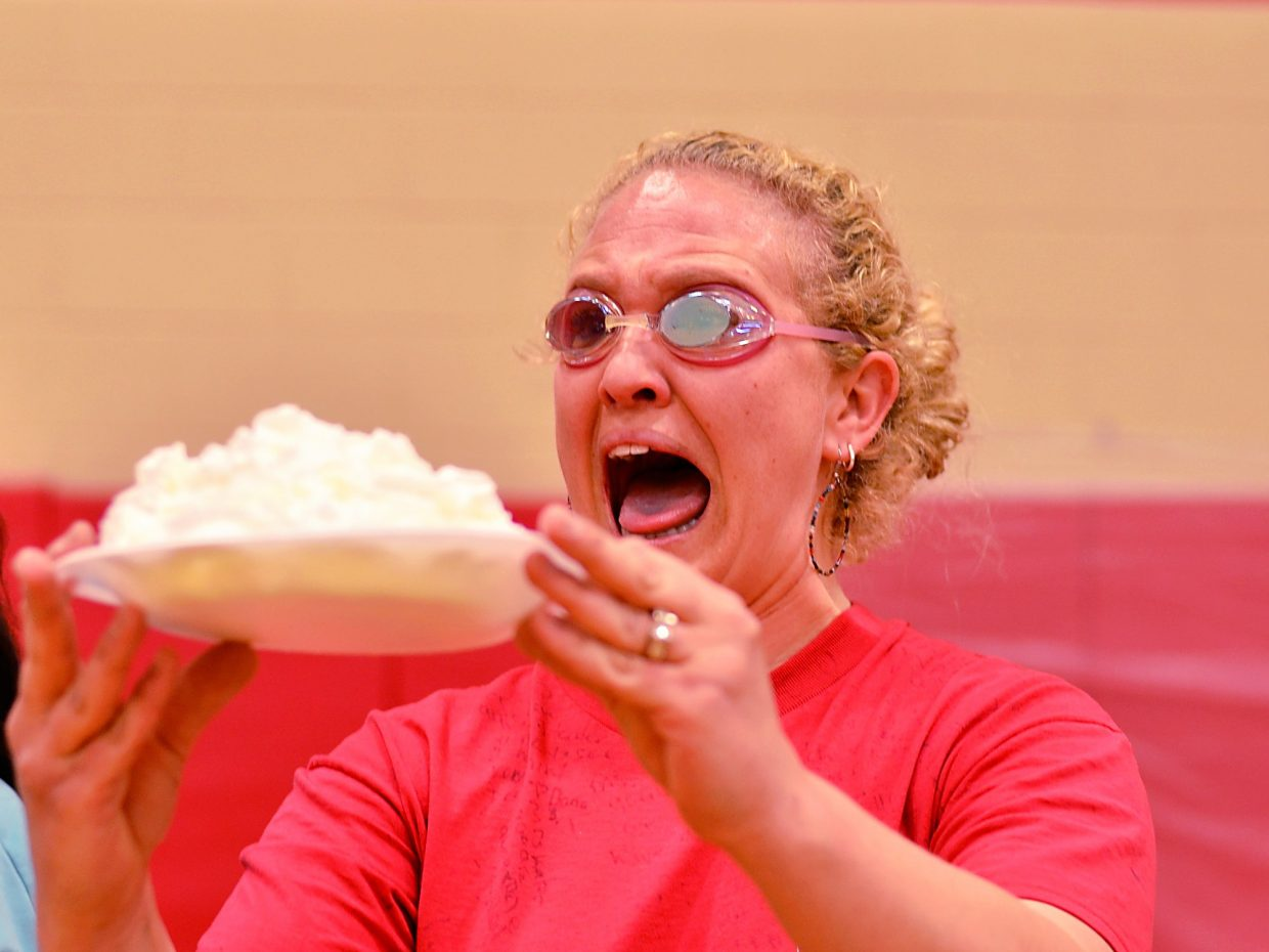 Seventh grade teacher Kristen Loebach gets ready to receive a pie to the face on Friday afternoon at Glenwood Springs Middle School.