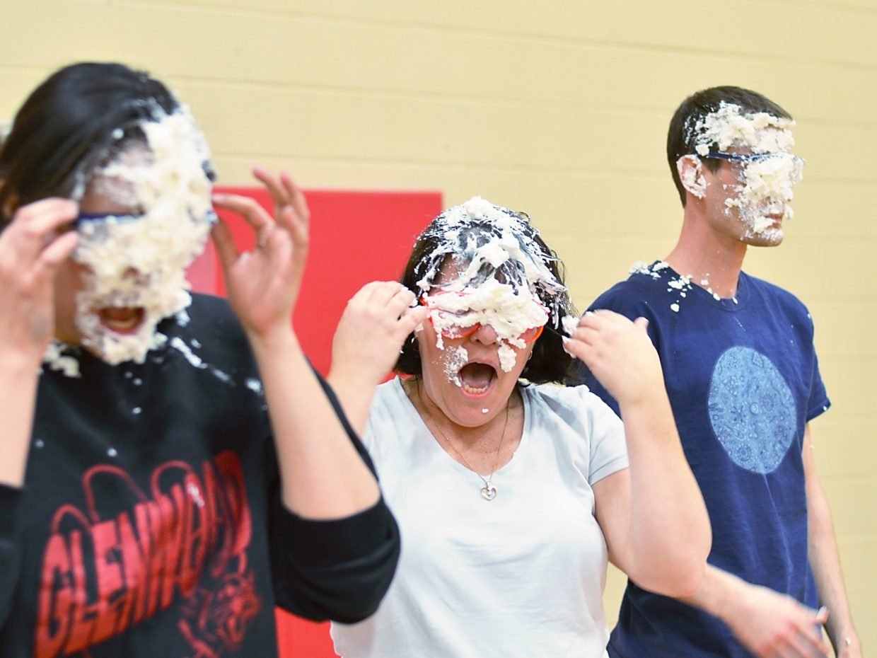 throws a pie into school resource officer Chris Dietrich's (her dad's) face.