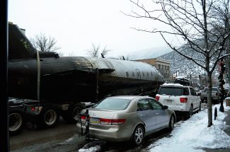 A semitruck hauls the private jet that crashed at the Pitkin County Airport on Monday through downtown Glenwood Springs on Wednesday afternoon.