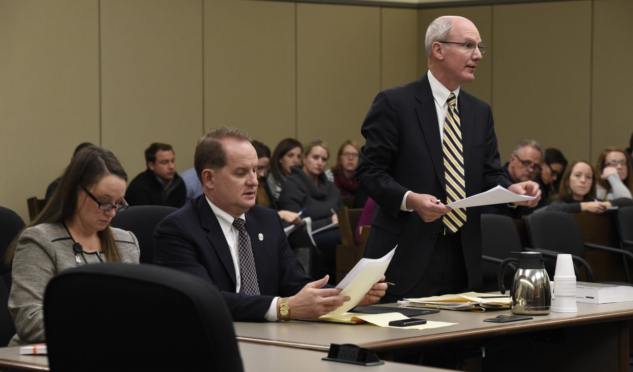 Fourth Judicial District Attorney Dan May, right, speaks Monday, during the first court appearance via video for Colorado Springs Planned Parenthood shooting suspect Robert Dear. Also pictured are prosecutors Donna Billek, left, and Jeff Lindsey, center.
