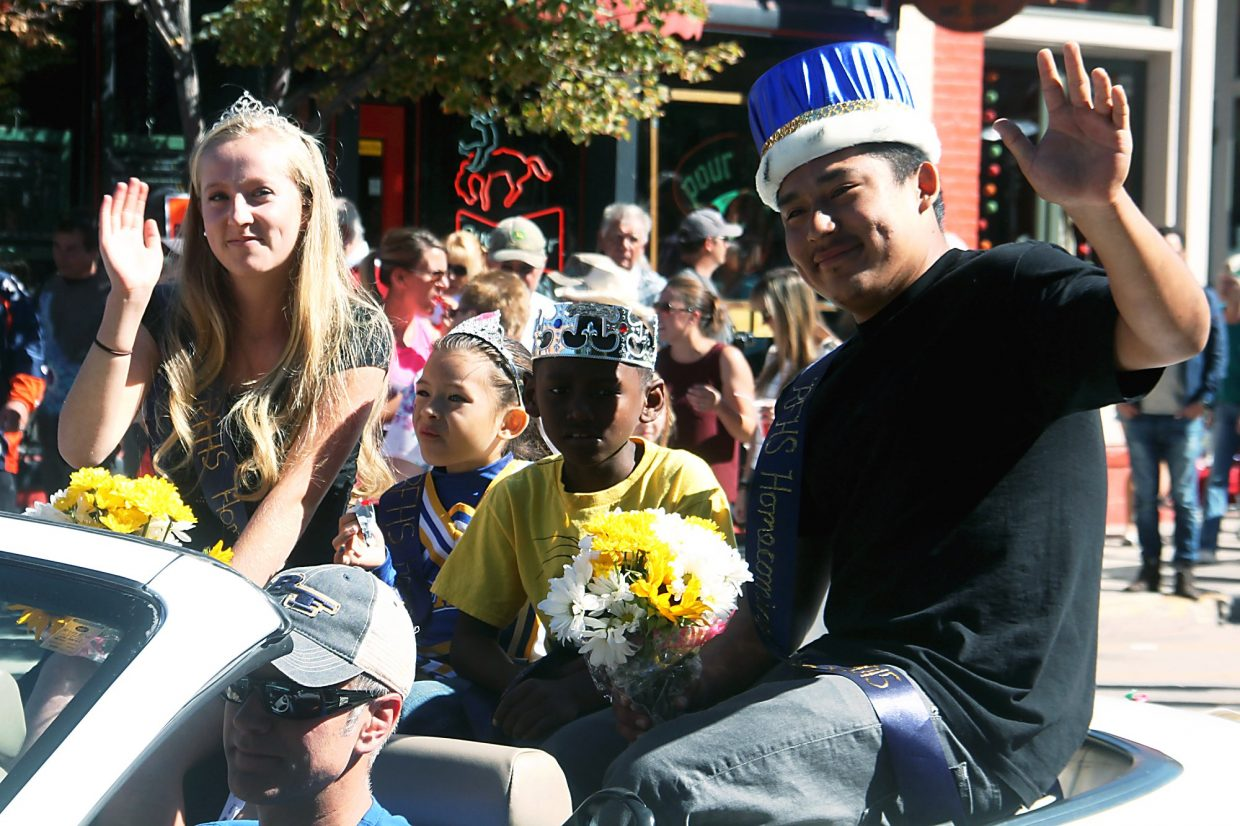 Homecoming Queen Fiona Laird and Homecoming King Conrado Dolores were chauffeured through the Potato Day parade in a convertible.