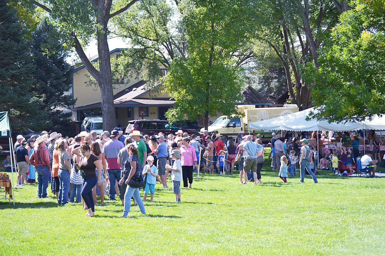 By the time the Potato Day barbecue in Sopris Park started at noon, a line of people stretched from the tent to the edge of the park.