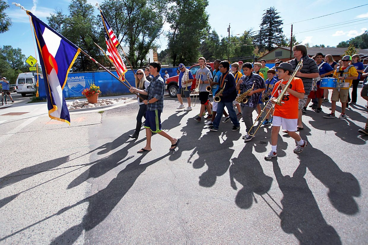 Christopher Mullen Post Independent The Roaring Fork High School Band walks to the start of the Potato Day parade in Carbondale Saturday morning.