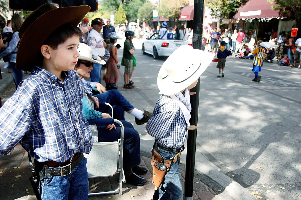 Christopher Mullen Post Independent Lucas and his brother Ethan Villarreal watch the Potato Day parade pass by as it travels down Main Street in Carbondale Saturday morning.