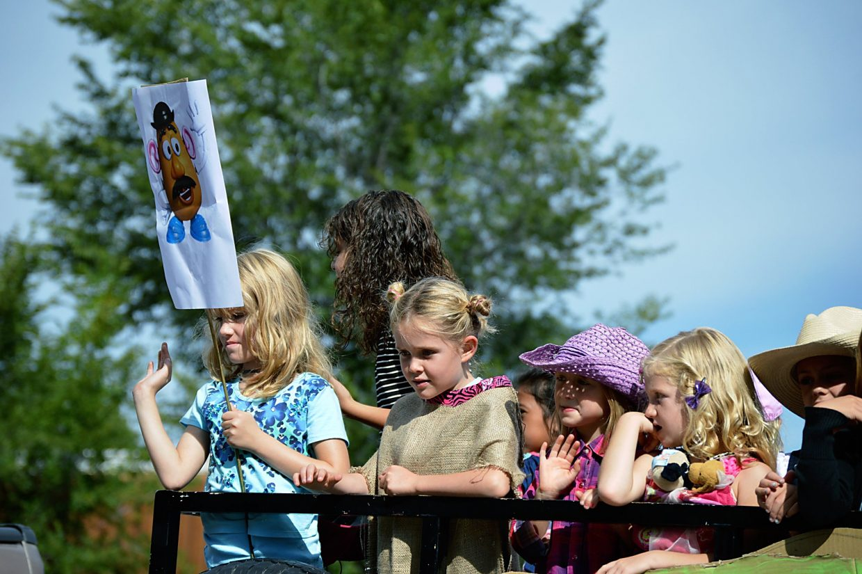 A little girl holds up a picture of Mr. Potato Head during Carbondale's annual Potato Day parade down Main Street on Saturday.