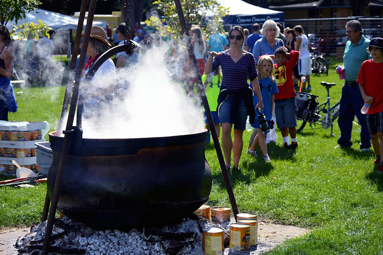 A cauldron of coffee heats up in Sopris Park during Potato Day last year.