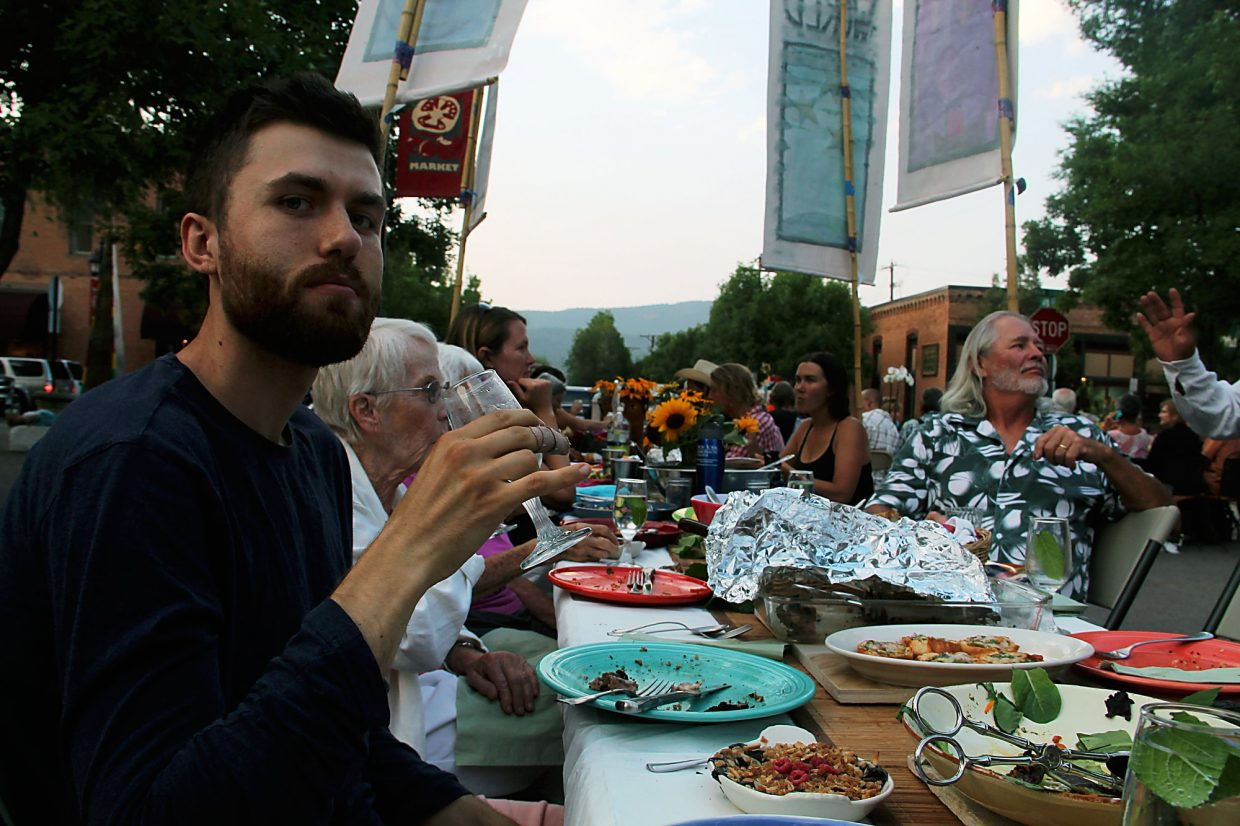 Clay Hawkins savors a moment at Carbondale's community potluck.