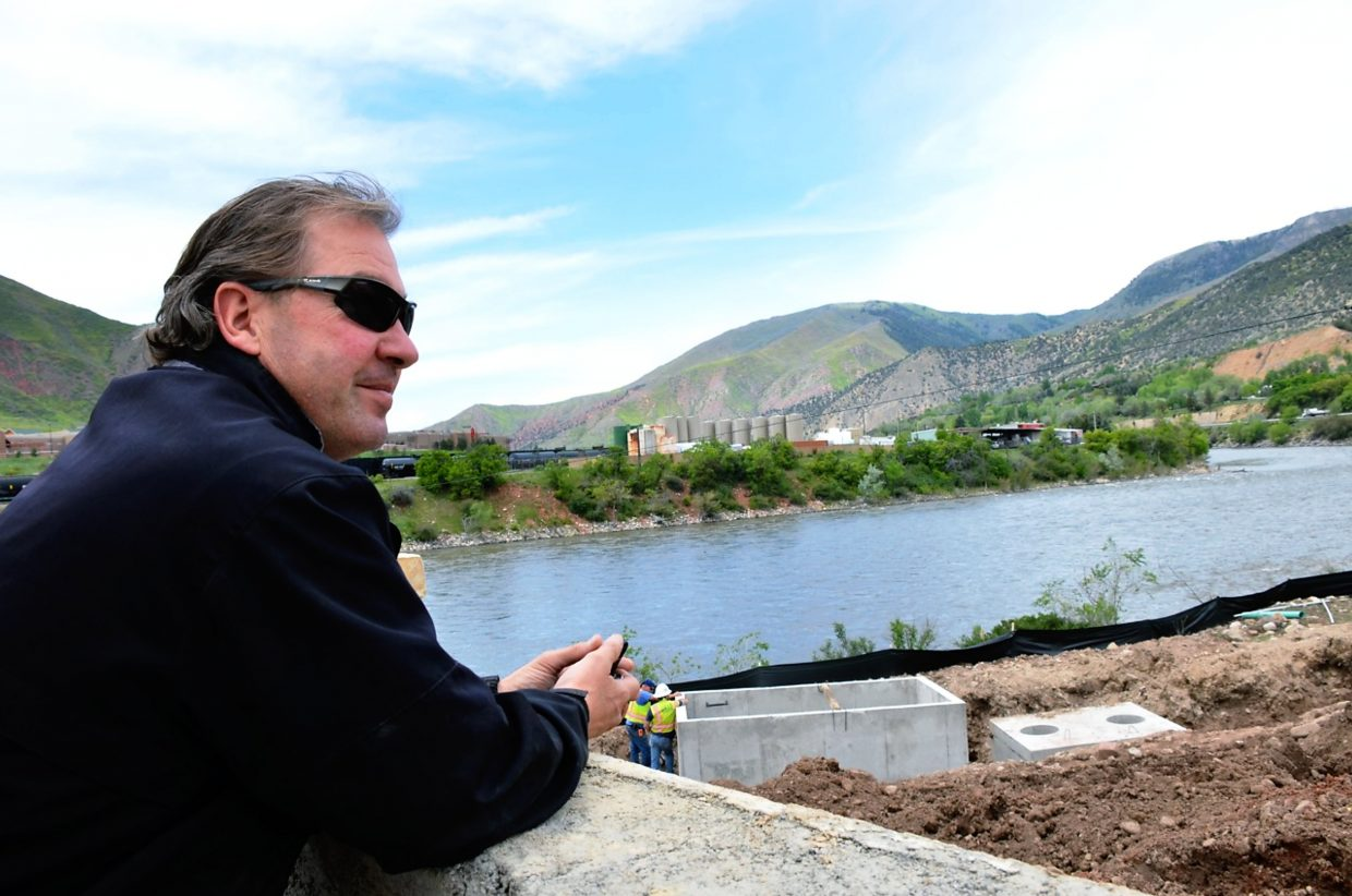 Steve Beckley, who reintroduced the public to Glenwood Springs' Fairy Caves 16 years ago, surveys the work now under way to reintroduce another of Glenwood's historic attractions, the Iron Mountain Hot Springs on the bank of the Colorado River.